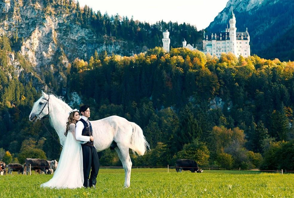 Bavaria Neuschwanstein Castle - This is where romance and fantasy meet. If it weren't for the cows grazing in the middle-ground, we might think this was a Disney Cel Painting for the latest Cinderella movie. Seemingly a dream, but somehow real life.