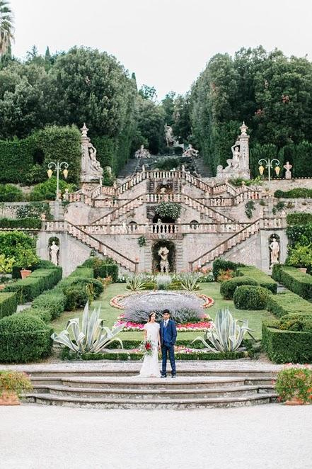 Photo by: Maria Lamb Photography - Vittoriale degli Italiani, built in the early 1900's by beloved Italian poet Gabriele d'Annunzio, is the spot to be for an enchanting experience. Centered right under these eye-catching, formidable sculptures, the couple's stance is striking in simplicity against the staggering embellishments of this formal garden.