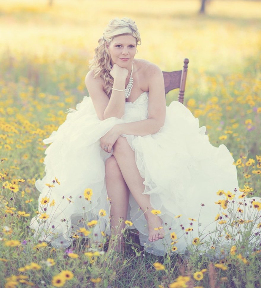 Photo by Moore Than Photography - No need for plush, tufted velvet, this relaxed bride takes her seat to a field of wild yellow daisies creating the perfect chic country portrait.