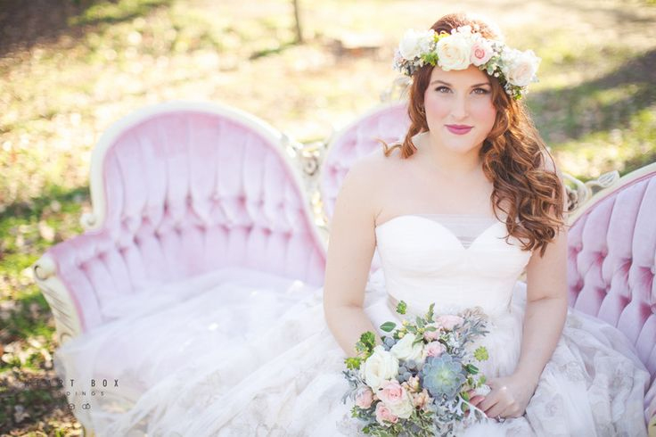 Photo by Heart Box Weddings - With a gorgeously tufted french loveseat as her main backdrop, her cocktail-style dress, and her sophisticated floral accents, this bride combines the best of the Victorian Era, the 1950s, and the modern bohemian movement with beauty and grace.