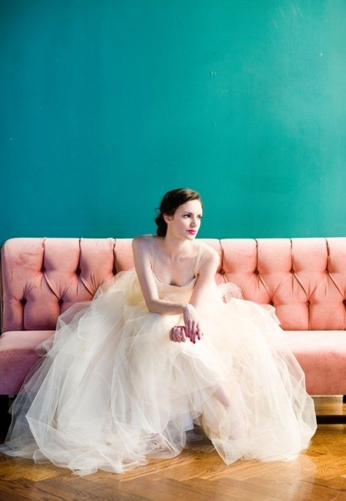 "Photo via Carol Hannah - This image may look familiar to you. The wide expanse of mussed tulle fabric, the bride casually leaning forward, and the white and teal color pairing are all reminiscent of a classic Marilyn Monroe ""ballerina"" photo shoot, shot by Milton Greene in the 1950s. This look is classic and casual, but stunning."