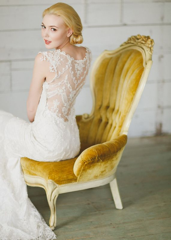 Photo by Apryl Ann Photography - Not every bride is the spitting image of Grace Kelly, but any bride can emulate that poise and sophistication with this pose. A subtle adjustment of a signature seat, a long, elegant back, and a glance over the shoulder creates the balance of romance and refinement.