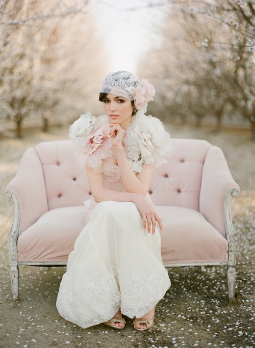 Photo by Stephanie Williams of This Modern Romance - An early 20th century loveseat, a coy pose, and a 1920s-inspired lace veil headdress has us dreaming of a wedding influenced by the Jazz Age, complete with flowing fringe accents and guests dancing the Charleston.
