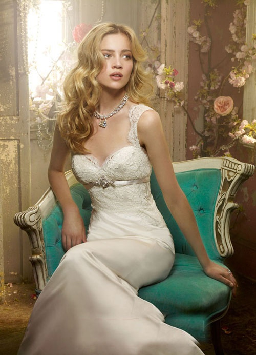 Photo via JLM Couture - Though this bride is seated in a shabby chic room with chipping paint and wild vines, the topsy-turvy blue chair draws your eyes immediately to the stunning lace and silk of her gown. The vines are bursting with soft blooms and hints at a jaunt through Wonderland. Perhaps she's looking for the White Rabbit?